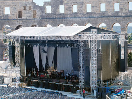 amplified: PULA, CROATIA - AUGUST 2nd  Leonard Cohen s stage is ready for the evening performance in Arena amphitheater in Pula on August 2nd, 2013