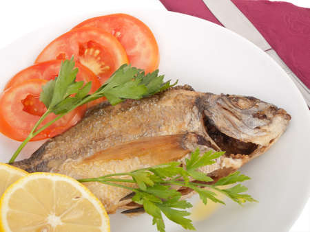 diplodus puntazzo, delicious grilled sheepshead bream, with sliced tomato, lemon and parsley; all in olive oil