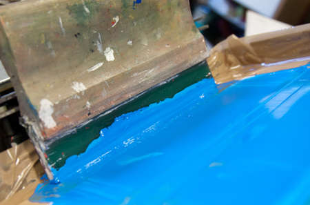 squeegee blade and hand holder on screen printing device