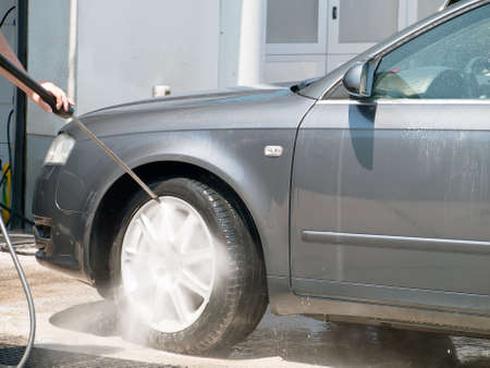 car washing with high pressure water jet Stock Photo