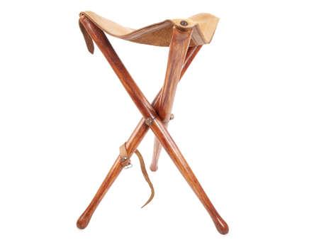 wooden hunting stool isolated on white background photo