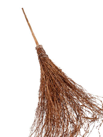 wicker work: brand new broomstick isolated on white, where is witch? Stock Photo