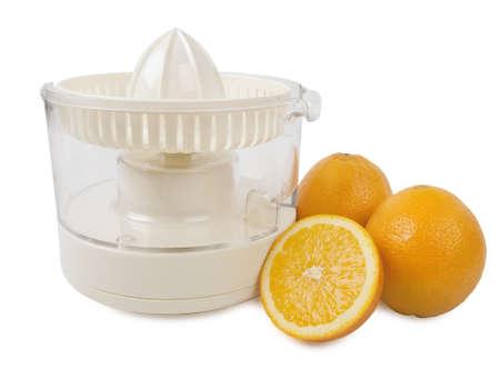juice squeezer: Juice squeezer with few oranges isolated on white  Stock Photo