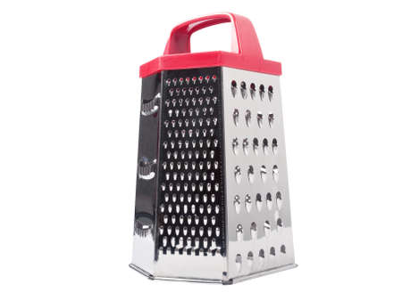 Metal grater with red handle isolated on white background photo