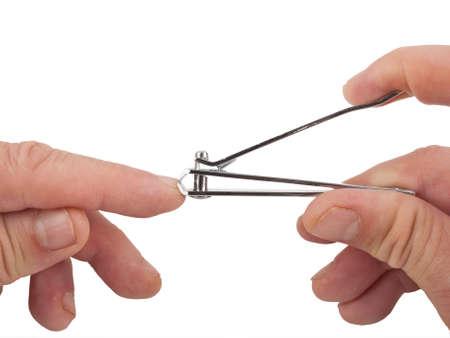 close up image of hands clipping nail