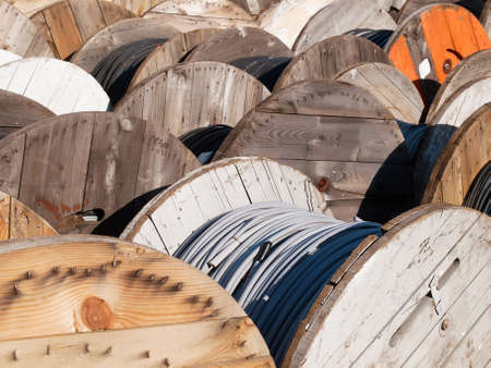 power cables: power line cables on wooden spools
