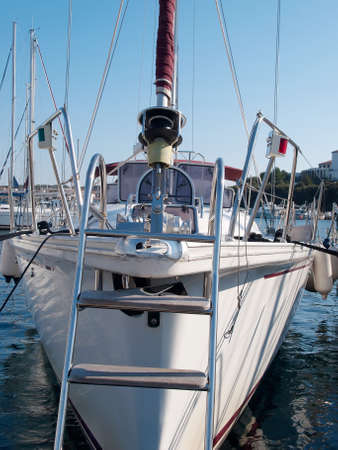 sailboat anchored in port, front view
