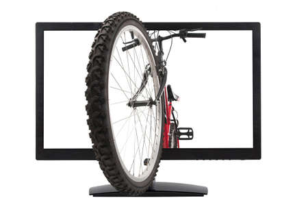 lcd monitor: front wheel of mountain bike and lcd monitor, isolated, studio shot Stock Photo