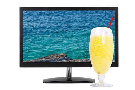 blue sea background against fresh summer juice photo