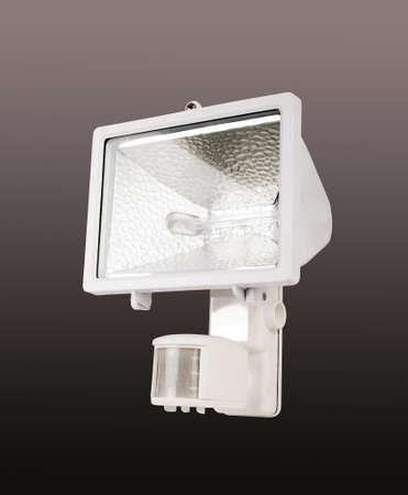 motion sensor: white spotlight with motion sensor, studio shot