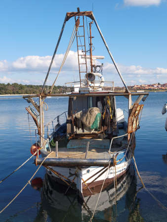 rustiness: old fishing boat anchored in port