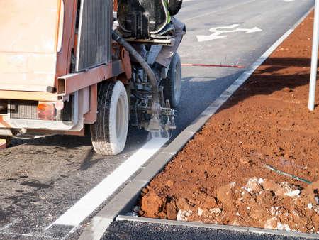 road surface marking works withs spray marking machine