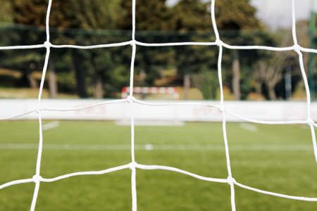 soccer net: view from soccer net and blurred goal against