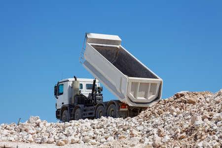 Tipper truck unload crushed rocks