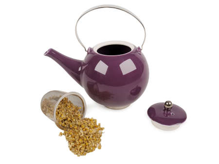 inox: porcelain teapot and camomile in inox filter Stock Photo