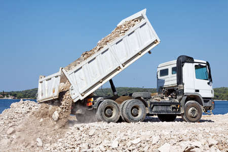 unload: tipper truck unload crushed rocks