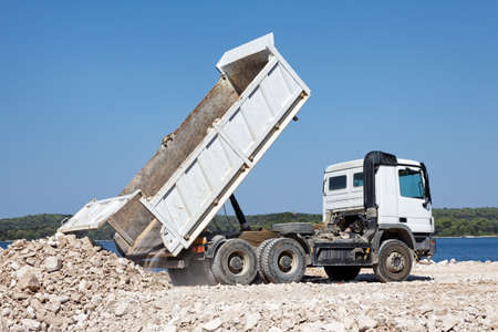 crushed: tipper truck unload crushed rocks