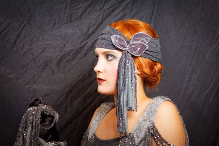twenties: beautiful flapper girl from vintage twenties posing