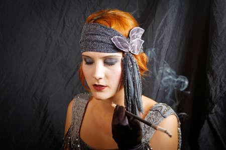 twenties: beautiful flapper girl from vintage twenties, smoking Stock Photo