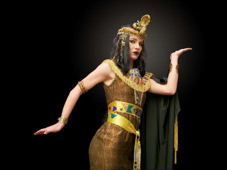 young girl dressed in Cleopatra costume, pose, studio shot,