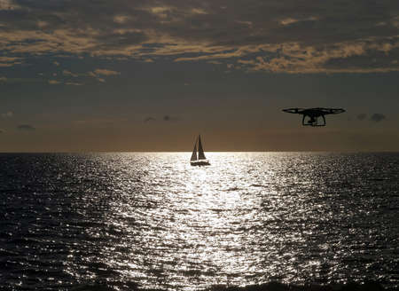 remote controlled: remote controlled drone flying above sea Stock Photo