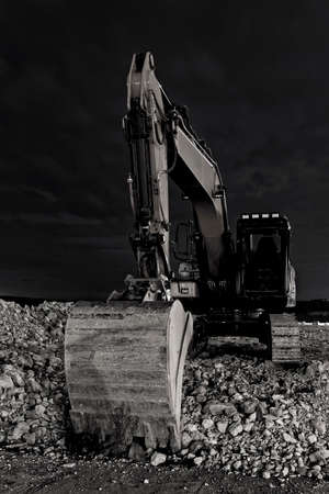 close up excavator at night, front view Stock Photo