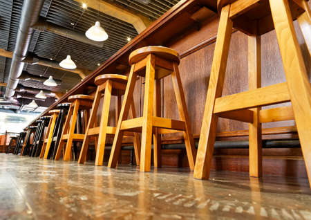 stool: wooden bar stools in a row