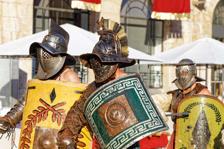 group of roman gladiators going to battle