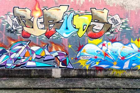 Pula, Croatia - November 9, 2017: The wall decorated with colourful abstract graffiti in Pula, Croatia