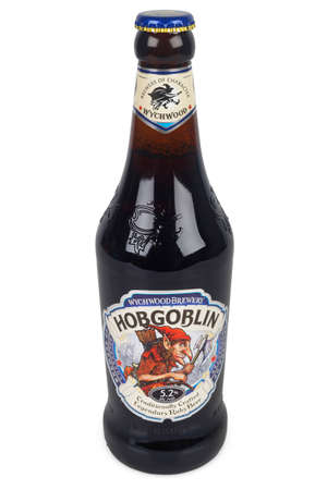 PULA, CROATIA - DECEMBER9, 2017: Bottle of Ruby Beer Wychwood Hobgoblin 500ml. Hobgoblin is a Extra Special style beer brewed by Wychwood Brewery Company Ltd in Witney, Oxon, United Kingdom.