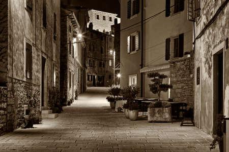 street in winter night in Bale, Istria, sepia toning