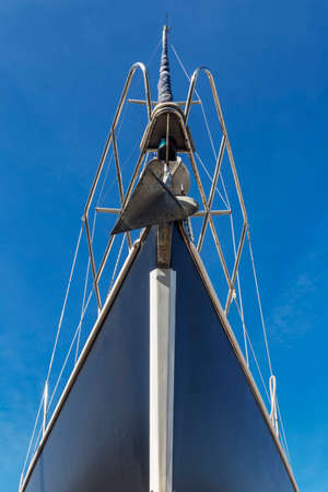 bow and mast on sailing boat, front view