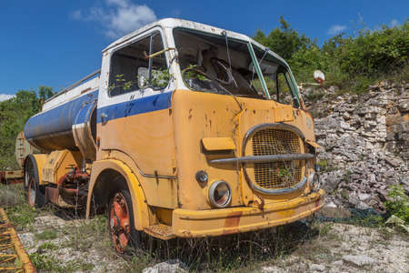 old yellow abandoned industrial truck