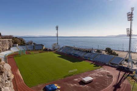 RIJEKA, CROATIA - DECEMBER 11, 2019: Attractive an unique football stadium of NK Rijeka. The Kantrida stadium is located between a large rock and the sea.