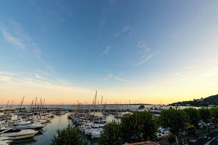 Sunset panorama from little harbor at Golfe Juan, Cote dAzur Imagens