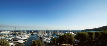 Panoramic view of a small harbor with lots of small ships at Golfe Juan, Cote dAzur