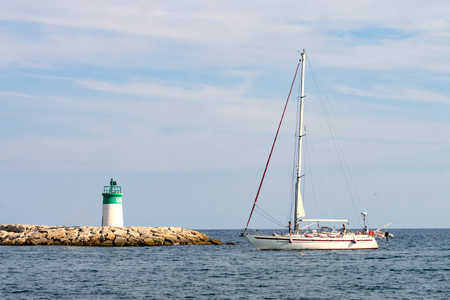 Sailboat being driven into harbor of Golfe Juan, Cote dAzur