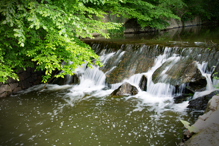 Small waterfall with green nature (Motion Blur) Stock Photo