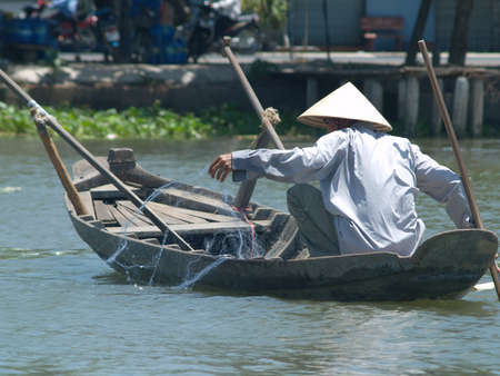fishing boat along mekong river photo