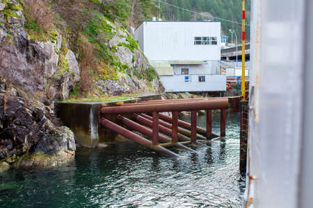 The berth for the BC Ferries dock in Horseshoe Bay, British-Columbia, uses large support beams (foundations) drilled into the rock face cliff beside it to anchor it and guide the boat in place