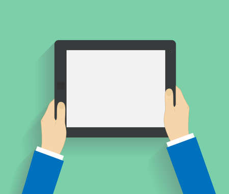 Business man holds holding tablet computer with white blank screen. Using digital tablet pc. Flat design concept with copy space.