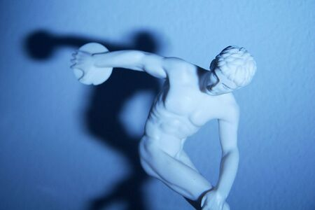 discus: Blue discus thrower statue