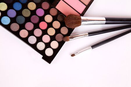 Makeup brushes and make-up eye shadows with blush photo