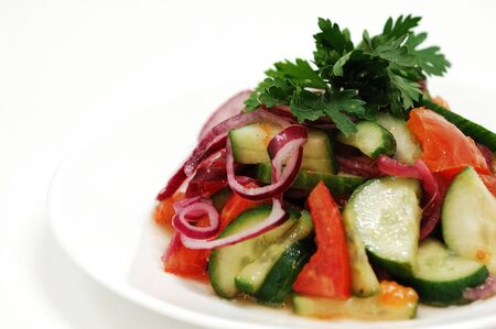 Salad with cucumber, onion and tomatos Stock Photo