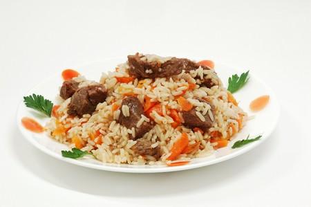 pilaff met rijst en voldoen Stockfoto
