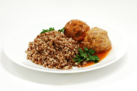 Dish with rissole and buckwheat in grav Stock Photo