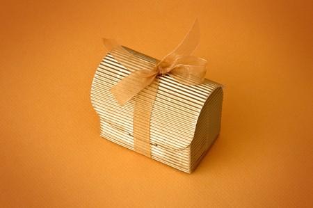 Little gift isolated on orange background Stock Photo