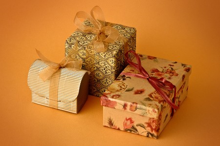 Three Little gift isolated on orange background Stock Photo