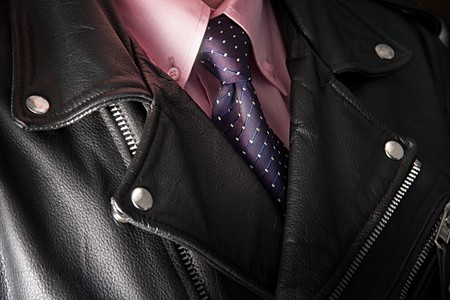 antithesis: Businessman in leather jacket with pink shirt