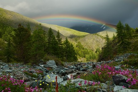 Rainbow in the mountainous region Stock Photo
